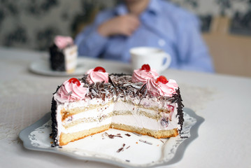 Cake with creamy flowers on  large plate