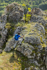 Young man hiking on the mountain
