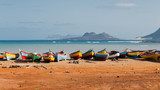 Fishing boats rest in Mindelo beach. - 74960827