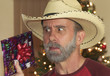 A Bearded Cowboy Tries to Guess His Christmas Present