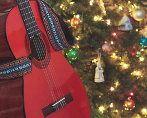 A Classical Guitar Beside a Christmas Tree