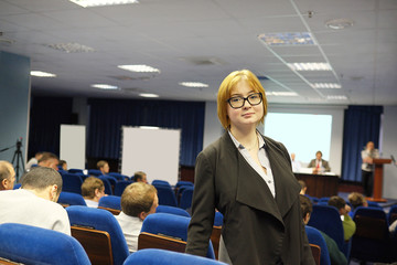woman standing in the conference hall
