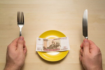 Plate with hundred rubles copyspace