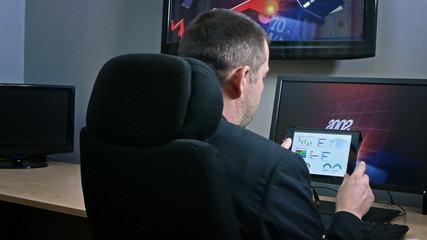 Businessman reviewing data on tablet device