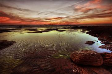 rocce, mare e tramonto