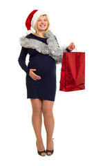 pregnant woman in santa hat shopping