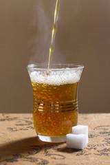 Pour Moroccan Mint Tea Into A Glass