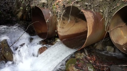 water pours from a pipe