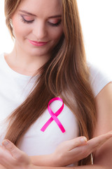 woman in t-shirt with pink cancer ribbon isolated