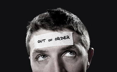 young man forehead tape text out of order in empty mind concept