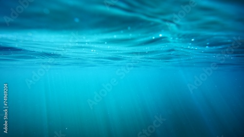 Foto op Aluminium Onder water Underwater view with sun beams in turquoise water