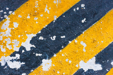 Old yellow and black lines painted on a boat