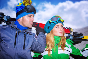 Portrait of a nice couple playing winter sports