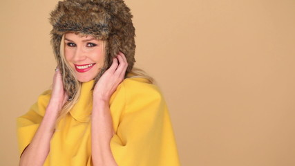 Pretty Woman in Yellow Fashion with Furry Hood