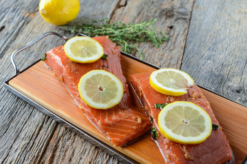 Salmon on a Cutting Board with Lemon, Salt and Pepper