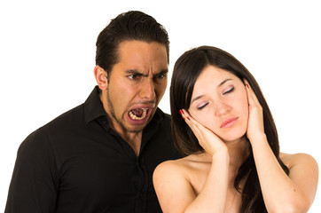 young attractive girl covering ears from angry screaming husband