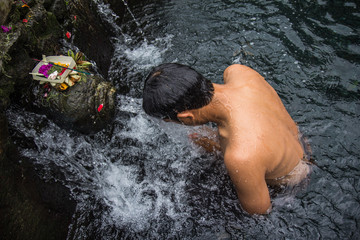 Holy spring water in Tirta Empul temple, Bali, Indones