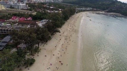 Flying over the city and the beach. Phuket.