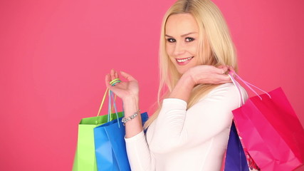 exited woman holding a shopping bags