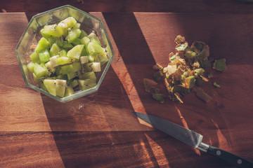 Kiwi and knife on wood