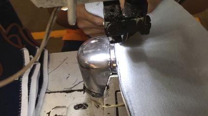 sewing machine stitching on textile