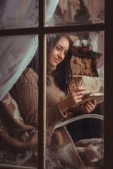 Girl Sitting In A Window
