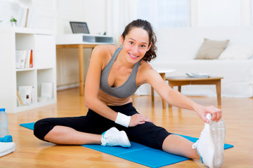 Young attractive woman stretching after sport