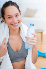 Woman drinking water after a sport session