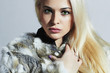 Beautiful blond woman in fur.winter fashion.Beauty Girl