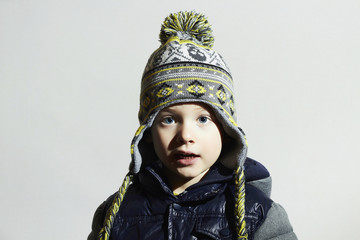 funny child.fashionable little boy in winter color cap