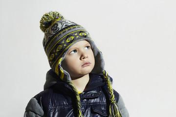 serious child.winter fashion kids.fashionable little boy in cap