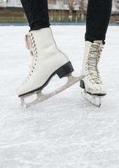 Female feet in figured fads on skating rink