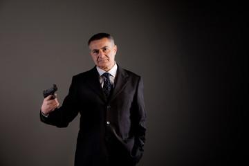 dangerous man in black and a gun