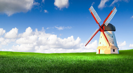 The windmill on the green wheat field.