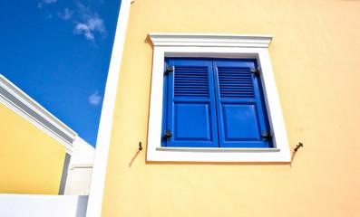 Closed blue window in greek style