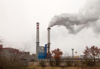 Factory, two smoking chimneys