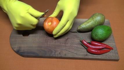 preparing cutting persimmon, pears and chili pepper