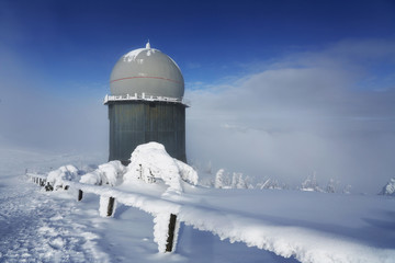 Ice-covered screen weather station, high on mountain-top