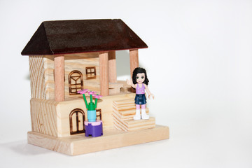 Wooden house and plastic toys