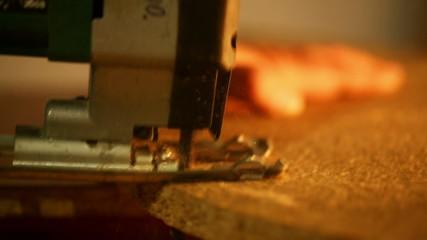 Carpenter at work - cutting wood jigsaw