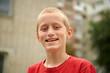 Ten year old boy having fun outdoors smiling