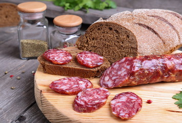 Sliced salami and bread on the kitchen table