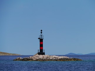 A black and red beacon in the Adriatic sea of Croatia