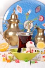 Turkish tea with lemon and oriental sweets