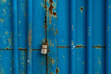 Padlock on blue steel doors