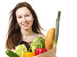 Young Woman Holding Large Bag of Healthly Groceries - Stock Imag