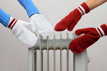 two people bask near the oil cooler gloves