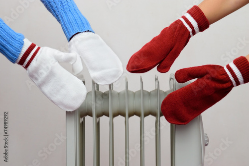 canvas print picture two people bask near the oil cooler gloves