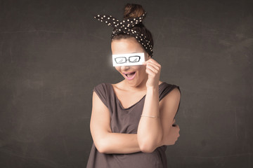 Happy girl looking with hand drawn paper eye glasses