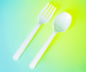 white plastic spoon and fork